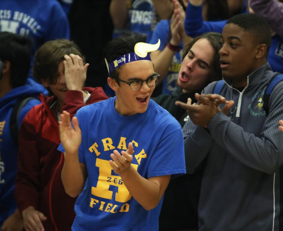 Senior Kane Katubig cheers with the crowd at the morning pep rally, Oct. 28.