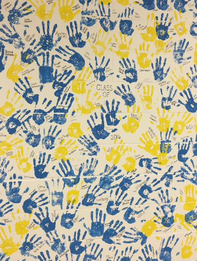 Class of 2016 senior hand prints soon to be painted over for 2017 seniors, located in upper commons.