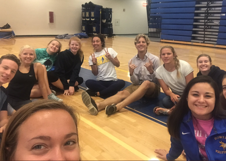 "11 students smile for a selfie at the first Viking Leadership Academy meeting in the main gym Wednesday morning, Aug. 30. Juniors and seniors discuss their goals as leaders of Howell. ""My favorite part of the meeting was getting into groups with people I didn't know and learning about them and their opinions,"" junior Lauren Holsclaw said."