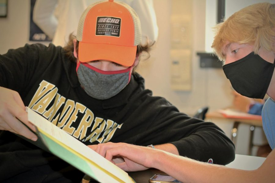 Juniors Alexander Richardson and Blake Walter work together on Pre-Calculus homework Sept. 10.